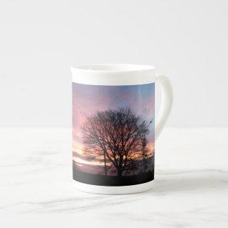 Tasse de porcelaine tendre de coucher du soleil de