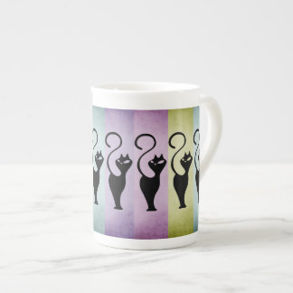 Tasse de thé de silhouette de chats noirs de