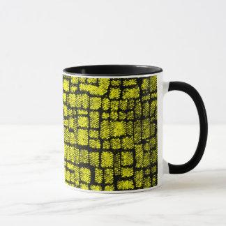 tasse jaune de mur