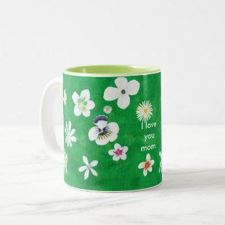 Tasses de maman de fleurs blanches de variété je