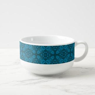 Tasses noires et bleues   de soupe à kaléidoscope