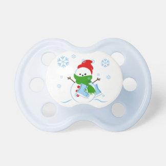 Tétine Bonhomme de neige mignon avec des patins de glace