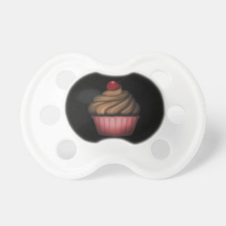 Tétine rose de bébé de fille de petit gâteau