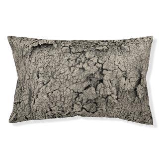 Texture criquée de cool de la terre lit pour chien