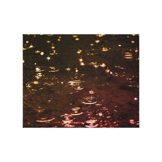 Toile Baisses de pluie dans le coucher du soleil de