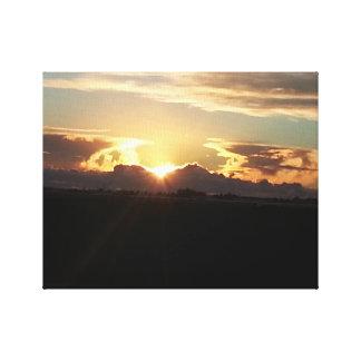 Toile Coucher du soleil au-dessus de la plaine