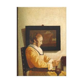 Toile Johannes Vermeer une lecture de jeune femme