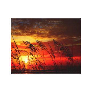 Toile Lever de soleil rouge par l'avoine de mer