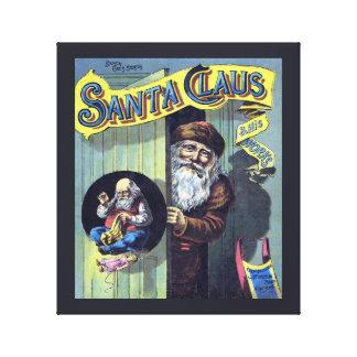 Toile Noël vintage, le père noël et son livre de travaux