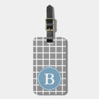 Trellis blanc sur le monogramme gris de bleu de la étiquette à bagage