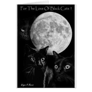 Trois chats noirs et la carte de voeux de lune