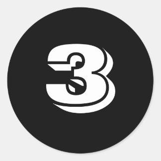 Trois petits autocollants noirs ronds de nombre