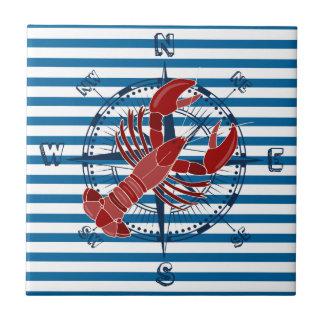 Tuile bleue et blanche de boussole et de homard de petit carreau carré