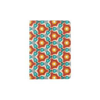 Une couverture orange et turquoise de passeport protège-passeport