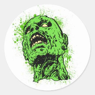 Visage de zombi sticker rond