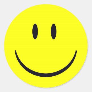 visage heureux sticker rond