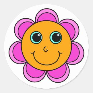 Visage rose et orange de smiley de fleur sticker rond