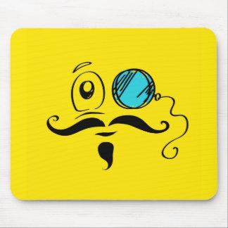 Visage souriant jaune de fantaisie avec le monocle tapis de souris