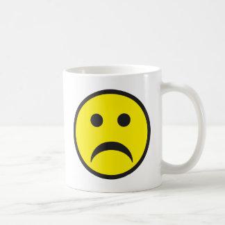 Visage souriant malheureux de tristesse mug