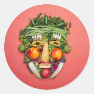 Visage végétal sticker rond
