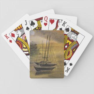 Voiliers amarrés sur des cartes de jeu jeu de cartes